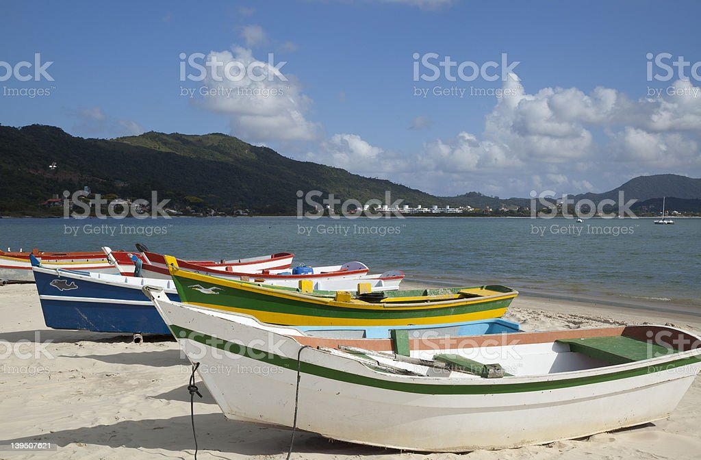 Boats on a Beach Next to the Ocean stock photo