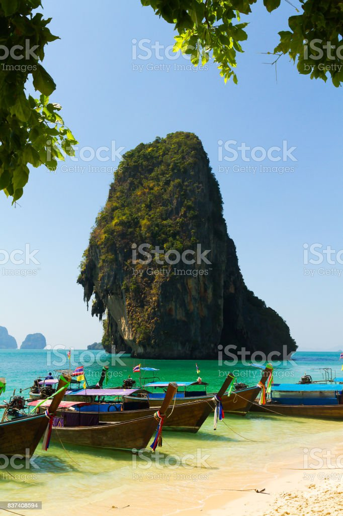 Boats on a beautiful beach in Thailand stock photo