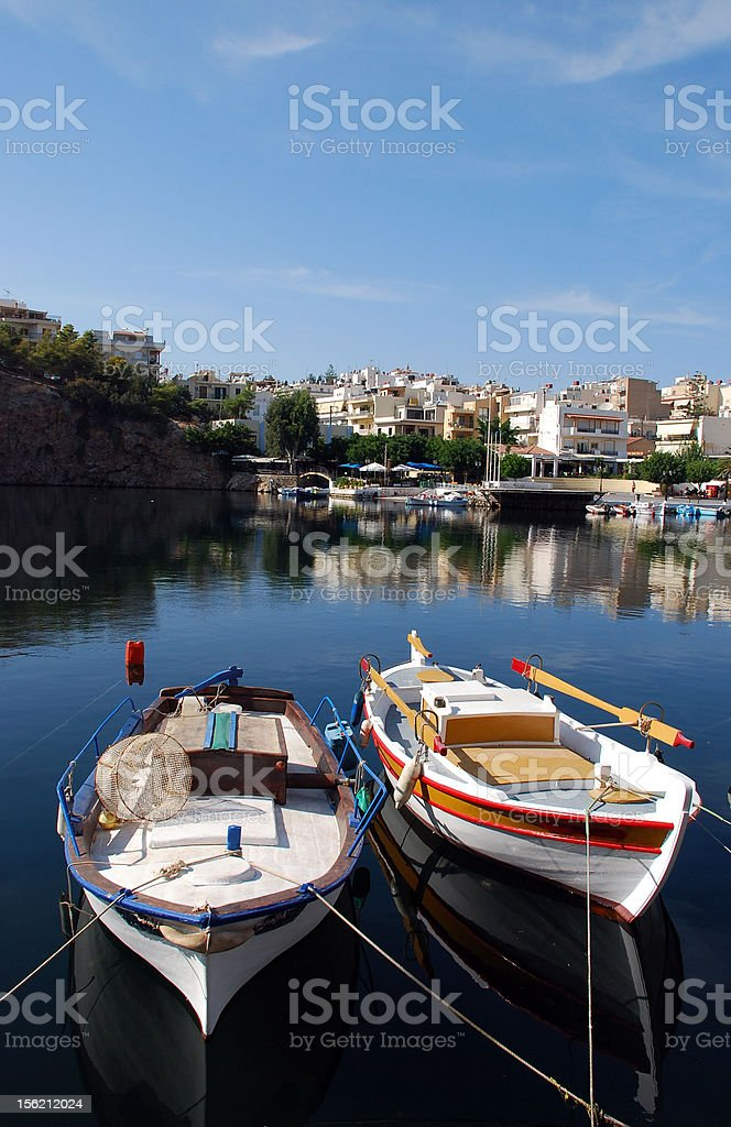 boats on Aghios Nikolaos lake royalty-free stock photo