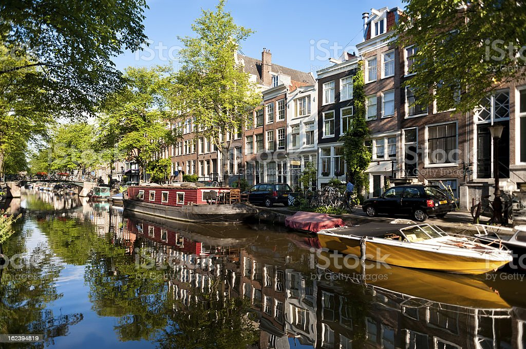 Boats on Amsterdam Canal stock photo