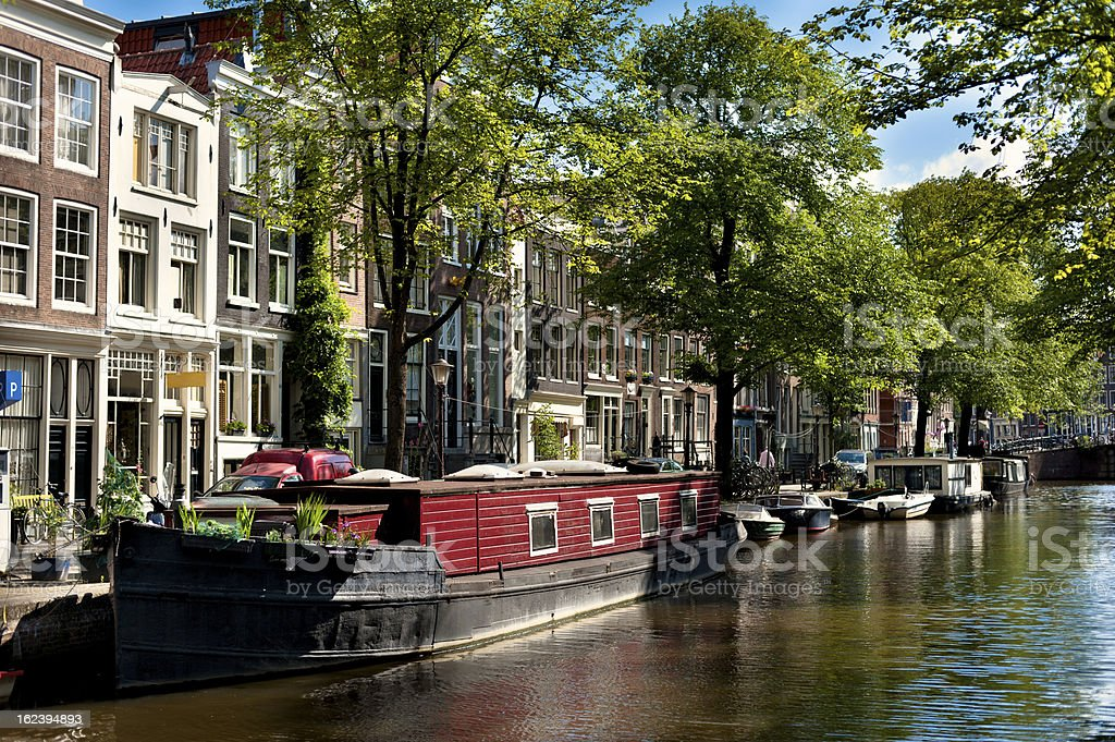Boats on Amsterdam Canal royalty-free stock photo