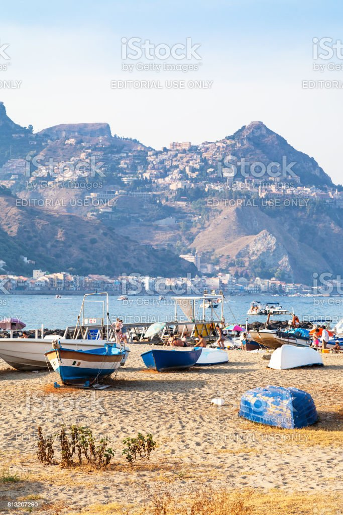 boats on beach in old port in Giardini Naxos town stock photo