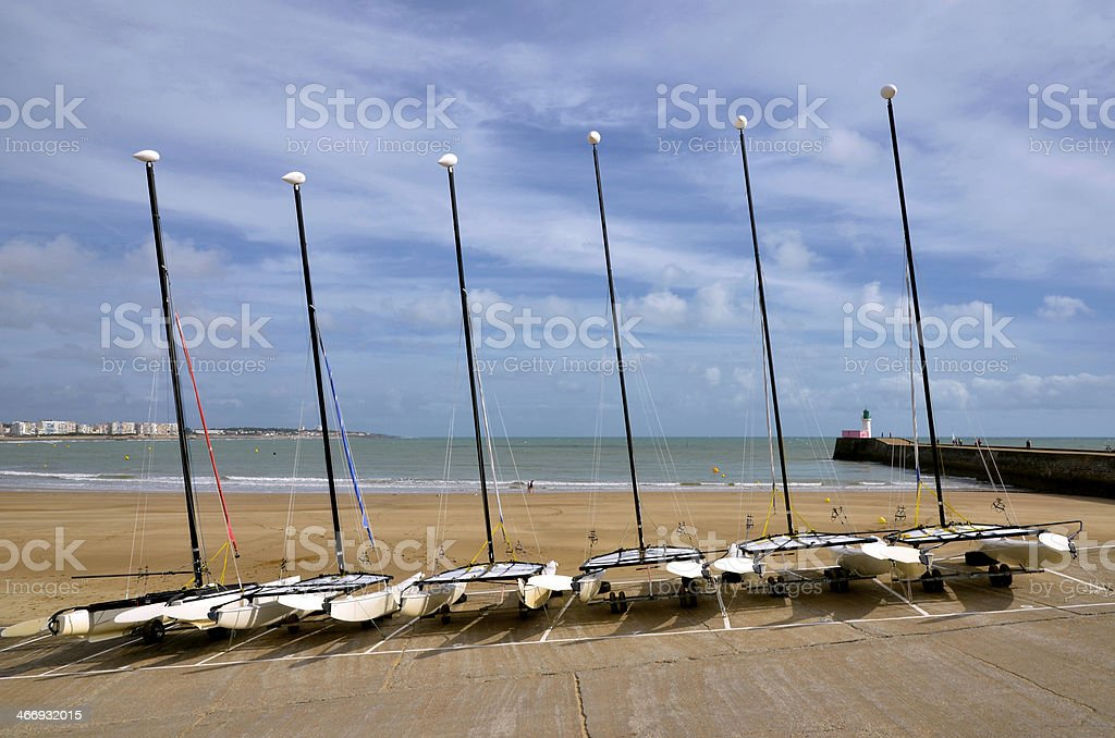 Boats on beach Les Sables d'Olonne in France stock photo