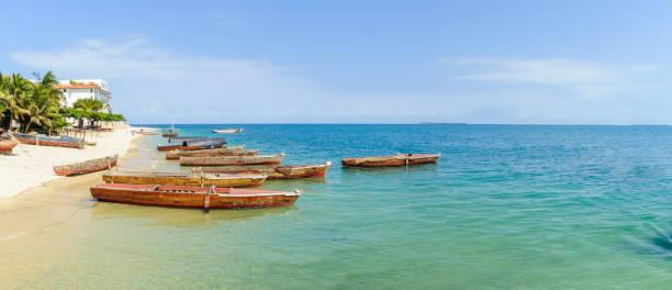 Boats on beach of Indian Ocean in Zanzibar stock photo