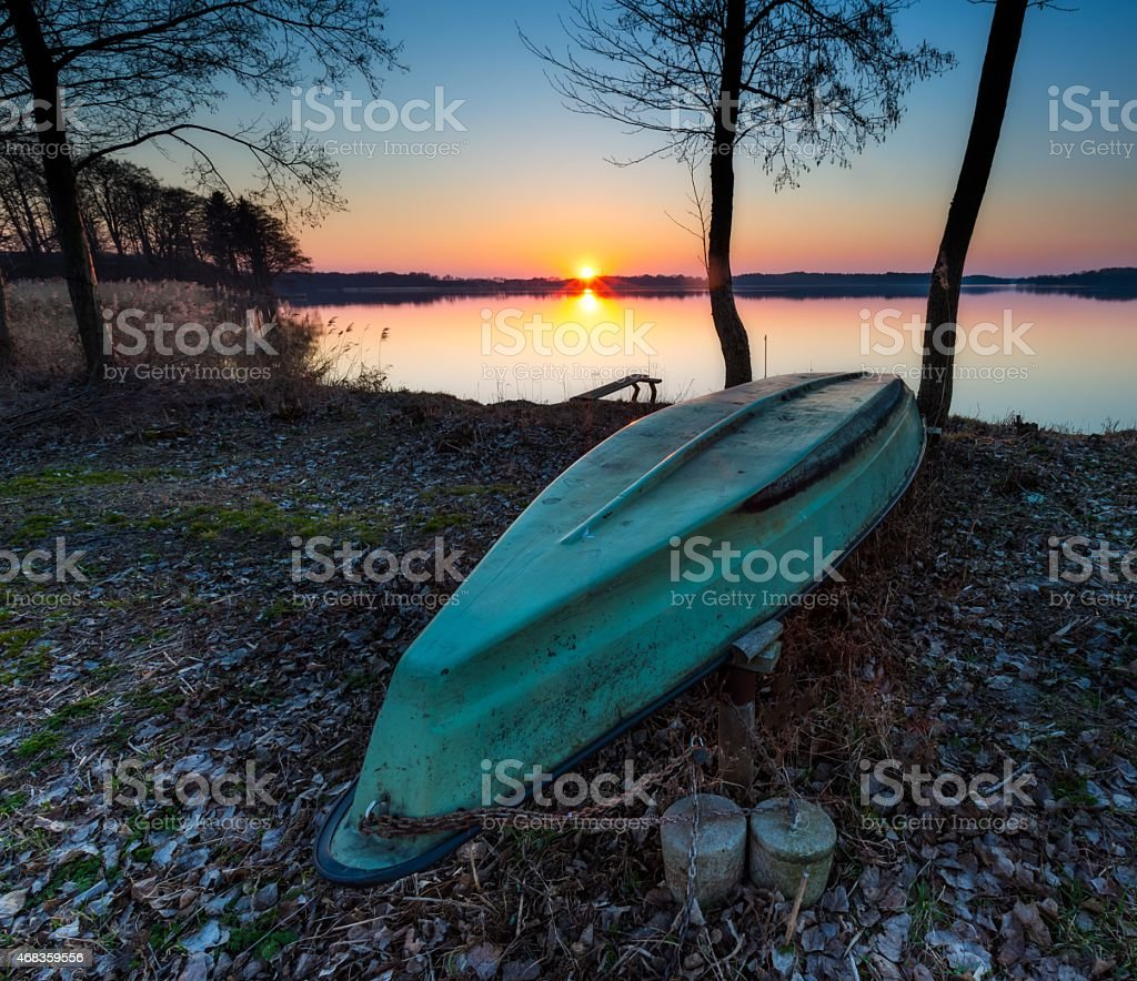Boats on lake shore at sunset royalty-free stock photo
