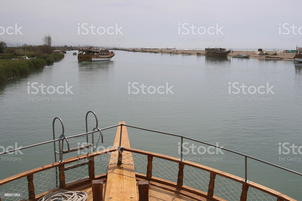 Boats on Manavgat river, in Turkey royalty-free stock photo