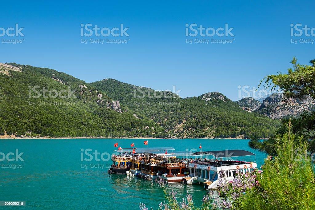 Boats on Manavgat river (Green canyon), Turkey stock photo
