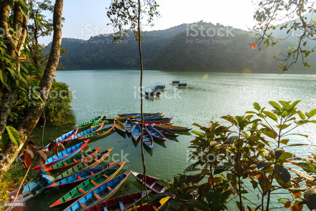 Boats on Phewa Lake in Pokhara, Nepal stock photo