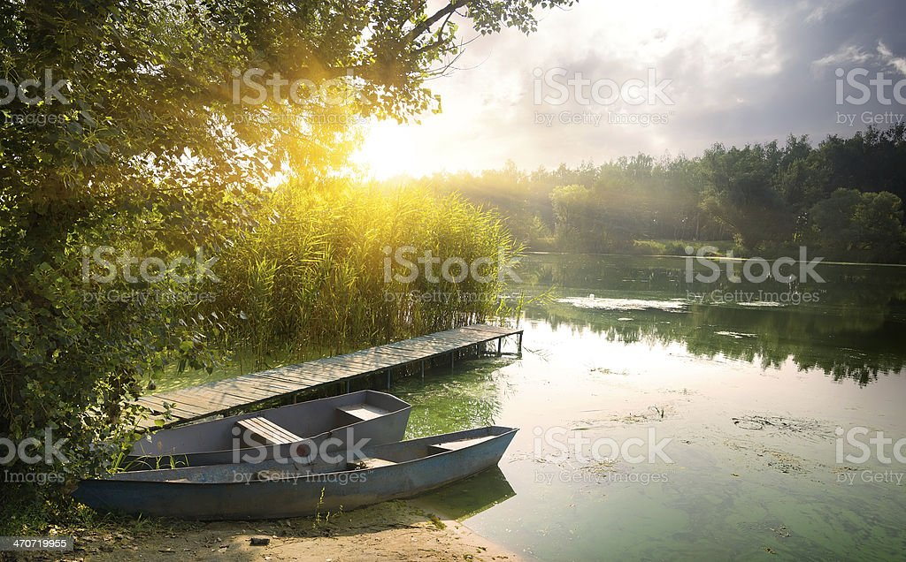 Boats on river stock photo