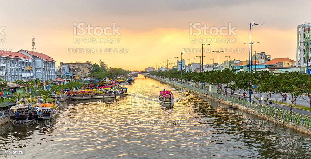 Boats on river wave flowers turn rays sunset royalty-free stock photo