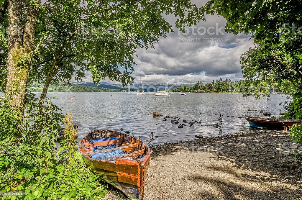 Boats on shore of Lake Windermere stock photo