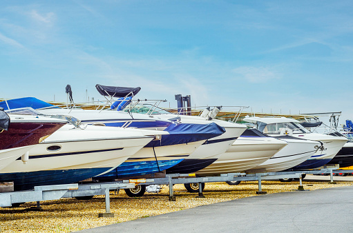 Boats on stand on the shore, luxury  yachts and ships, maintenance and parking place boat, sailing industry