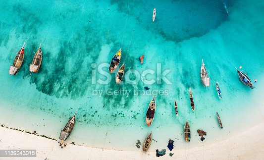 istock boats on the beautiful beach of Zanzibar, Africa 1139243015