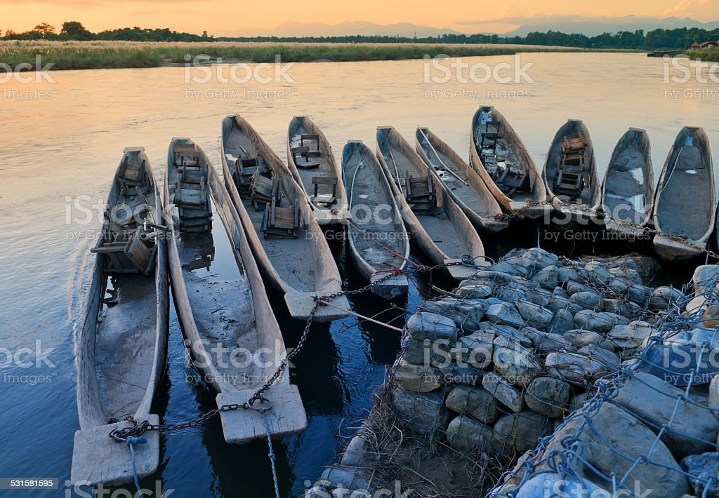 Boats on the mooring in Chitvan's national park in Nepal. stock photo