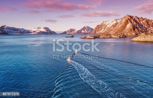 istock Boats on the sea during bright sunset. Beautiful natural concept and odea of travelling 937972370
