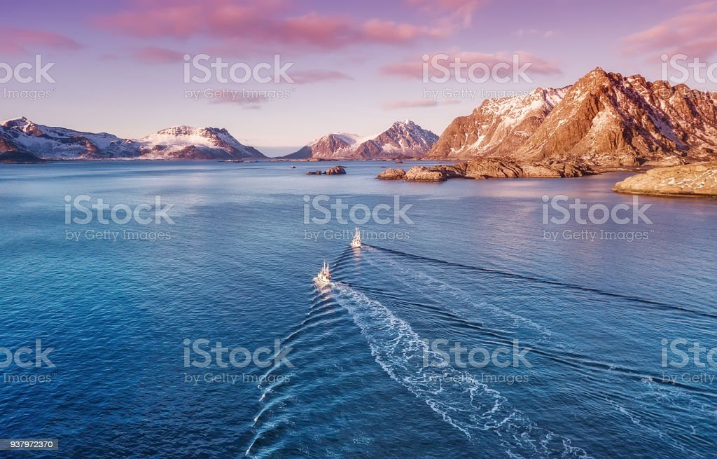 Boats on the sea during bright sunset. Beautiful natural concept and odea of travelling stock photo