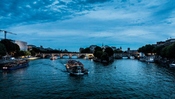 Boats on the Seine at dusk stock photo