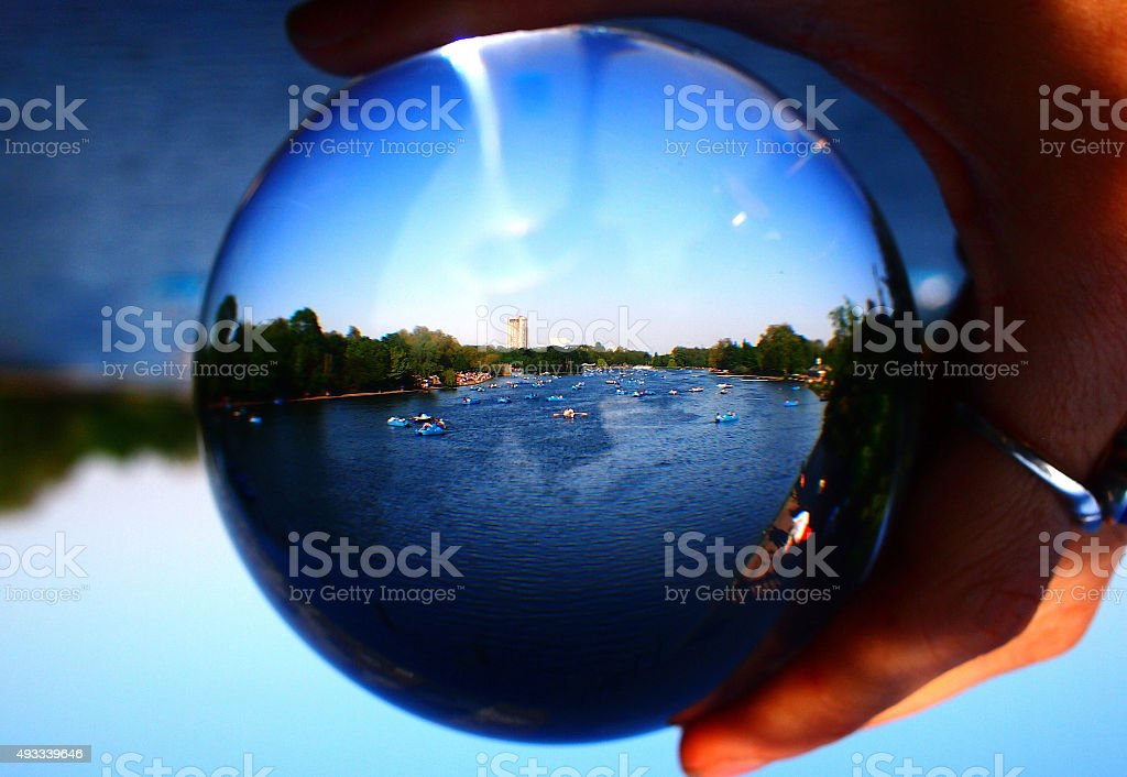 Boats on the Serpentine, through a crystal ball stock photo