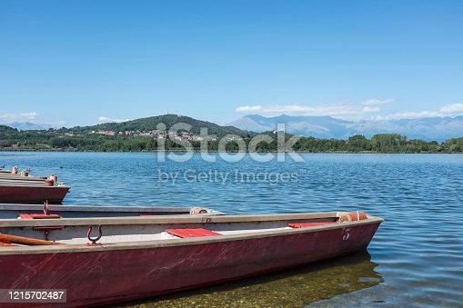 boats on the shore of a lake in Italy in a sunny day