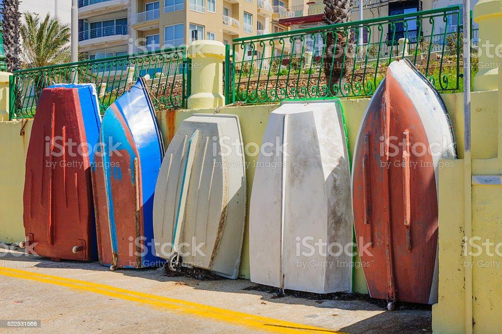 Boats on the street, in Qawra stock photo