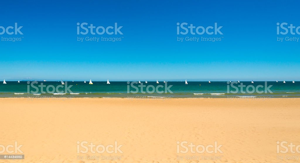 Boats on the water by sandy beaches, Poole near Bournemouth stock photo