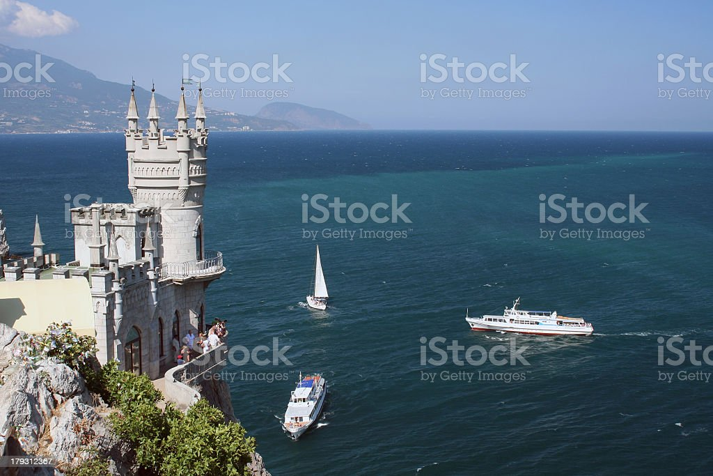 Boats on the water near the Swallows Nest in Crimea, Ukraine stock photo