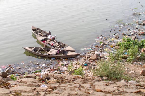 Boats on the Yamuna river, New Delhi stock photo