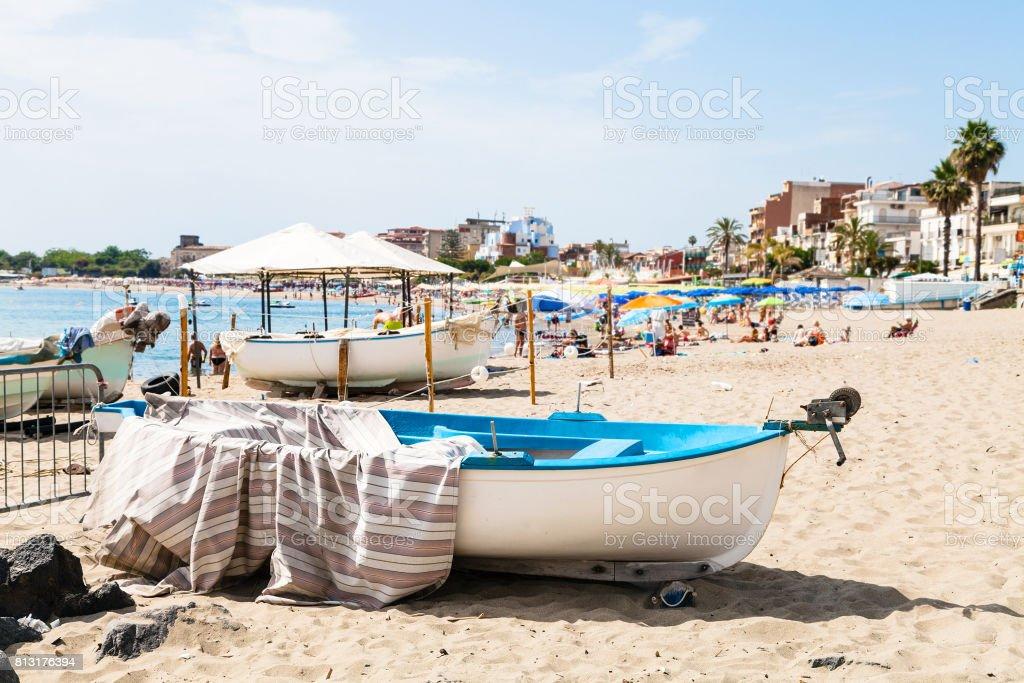 boats on urban beach in Giardini Naxos town stock photo