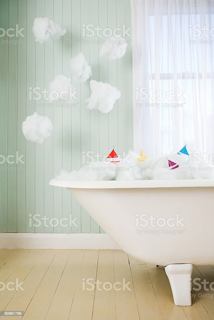 Boats on waves in a bath royalty-free stock photo