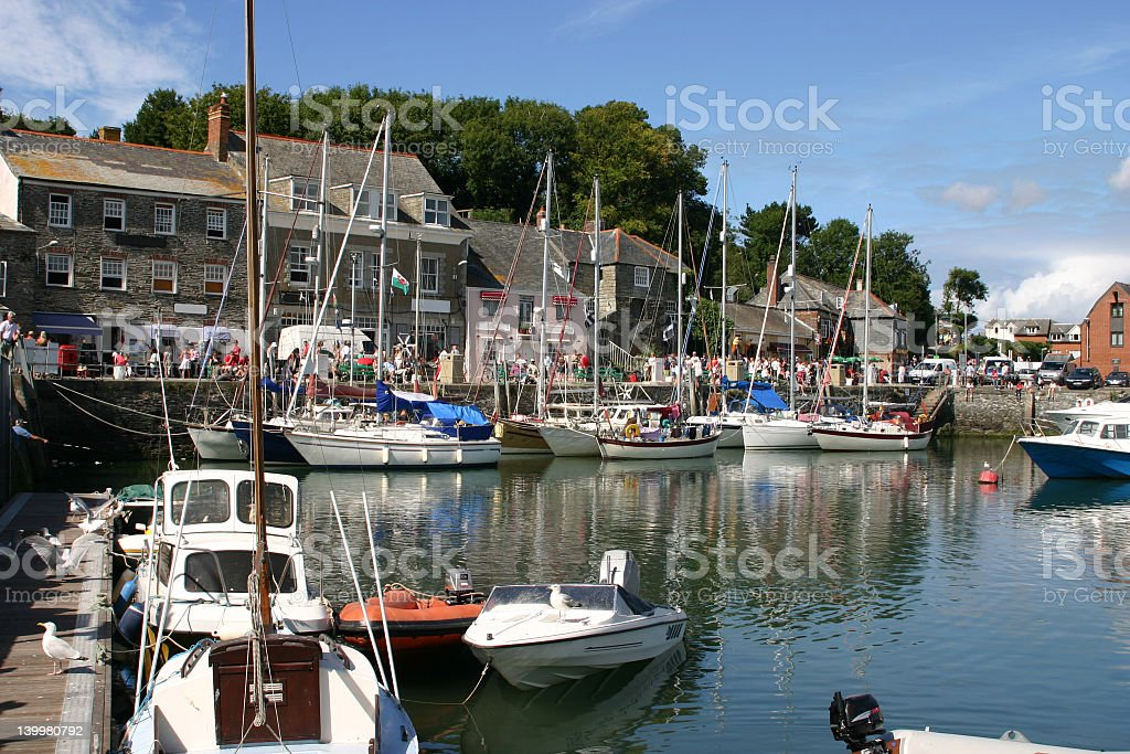 Boats parked along the docks at Padstow Harbor stock photo