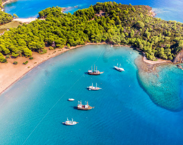 boats parking at phaselis cove - турция стоковые фото и изображения
