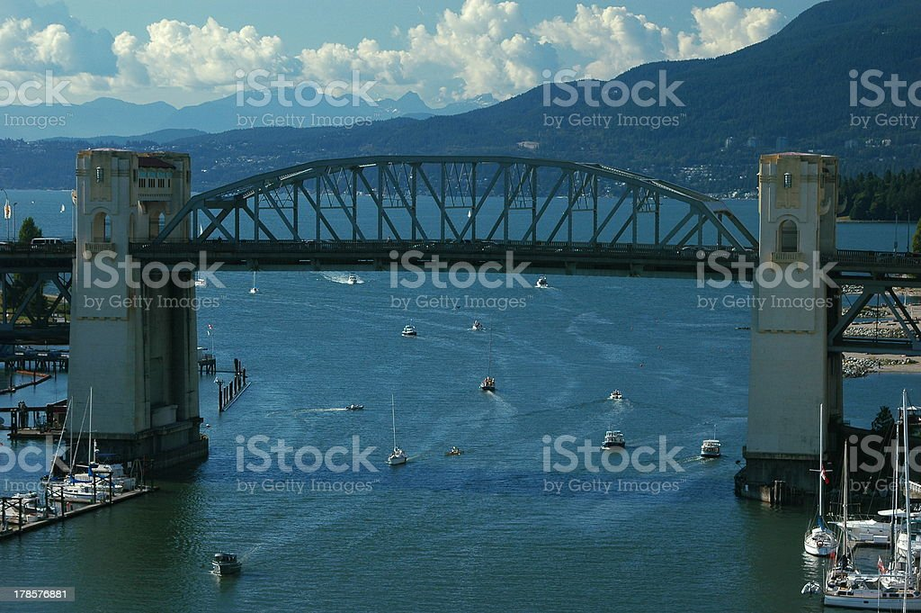 Boats pass under the Burrard Street Bridge royalty-free stock photo