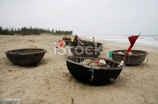 Boats at China Beach near Hoi An in central Vietnam.