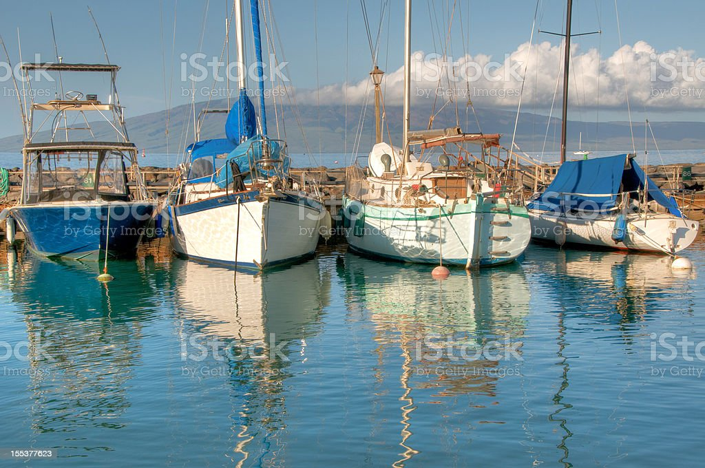 Boats reflected in calm harbour, Maui royalty-free stock photo