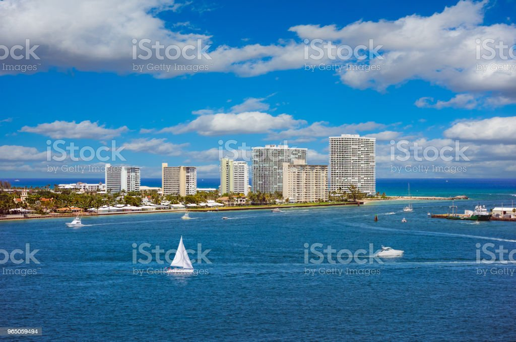 Boats sail  in front of Fort Lauderdale, Florida harbor zbiór zdjęć royalty-free