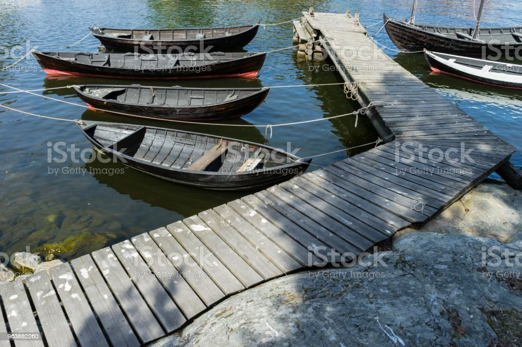 Boats strapped at pier - Royalty-free Blue Stock Photo