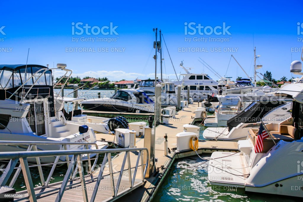 Boats tied up at the marina in Smokehouse Bay on Marco Island, Florida stock photo