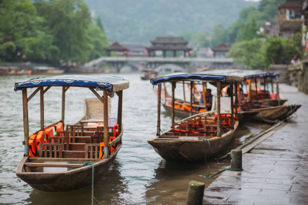 boats tours in Fenghuang Ancient Town, China stock photo