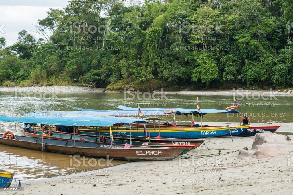 boats waiting for departure on the shore of the Napo river stock photo