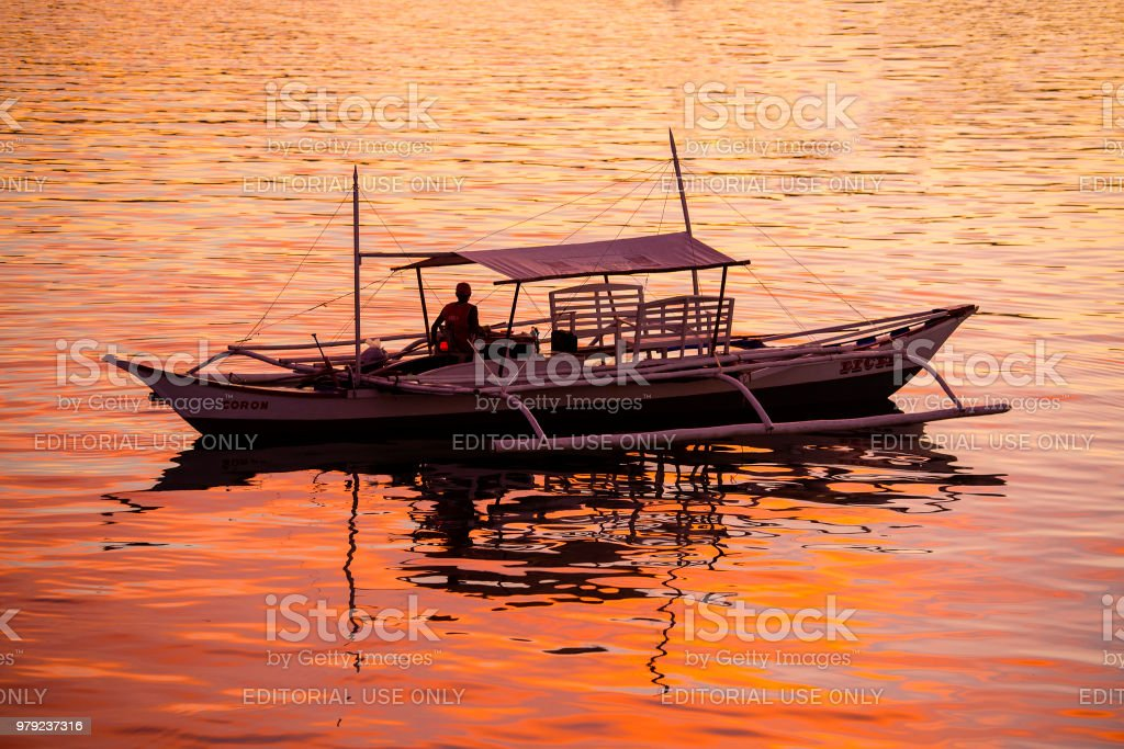 CORON, PHILIPPINES - Boats waiting for tourists to travel between the islands. stock photo