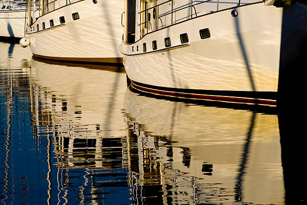 Boats with reflections on water stock photo
