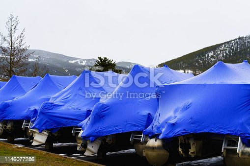 istock Boats Wrapped in Blue Plastic Tarp for Winter Storage 1146077286
