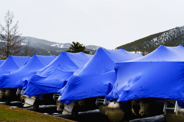 Boats Wrapped in Blue Plastic Tarp for Winter Storage stock photo