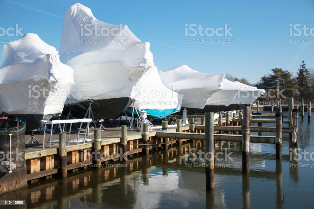 Boats wrapped up for winter stock photo