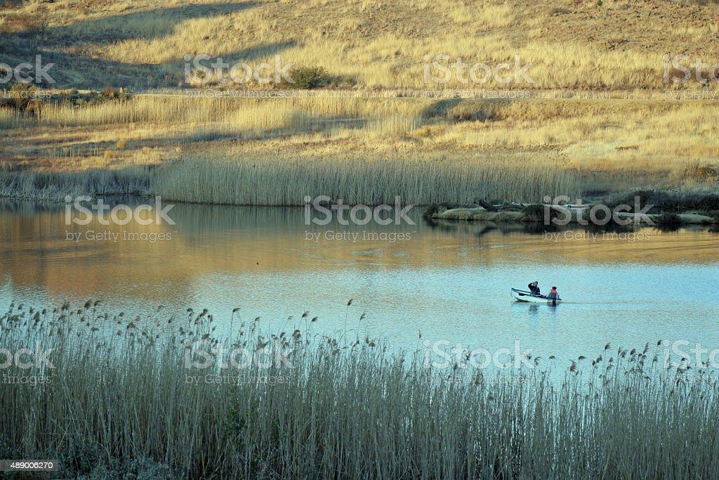 Boatsmen on lake stock photo