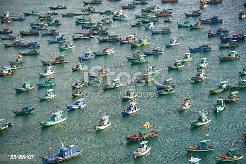 Aerial view of fishing boats in Phu Quoc, Vietnam, taken from a cable car.