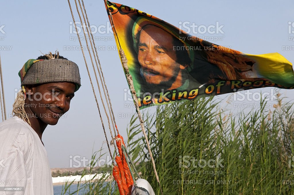 Bob Marley flag and Egyptian man in Egypt bildbanksfoto