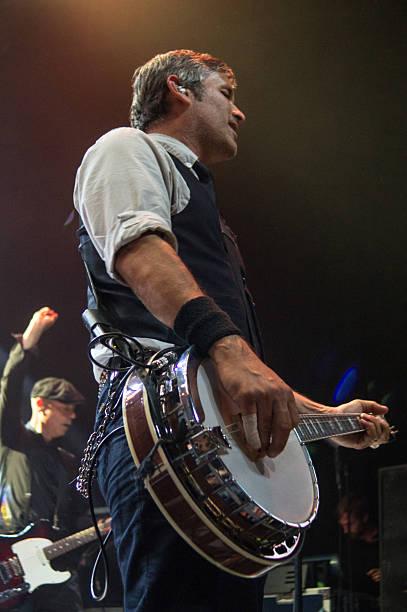 Bob Schmidt plays banjo with Flogging Molly in Dallas stock photo