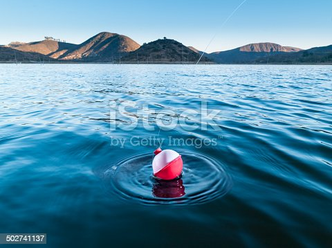 A fishing bobber indicating a fish on a lake in southern California.http://blog.michaelsvoboda.com/FishingBanner.jpg