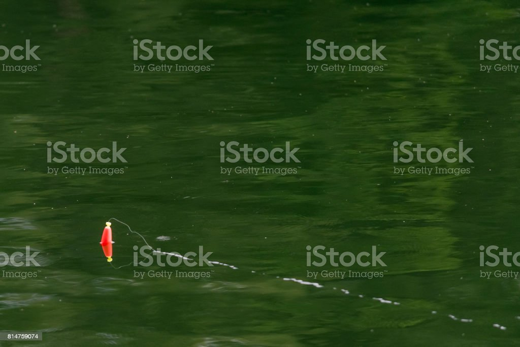 Bobber reflection in the lake stock photo